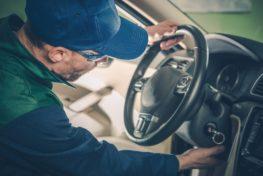 Car Recall Maintenance. Automotive Recall Concept. Technician Preparing Vehicle For the Repair.