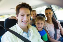 happy family inside the car