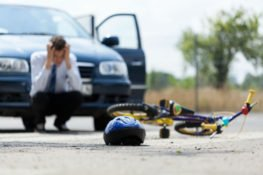 A man frustrated after an accident with a bicycle