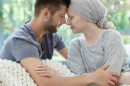 Cancer patient with husband after receiving treatment for ovarian cancer caused by talc baby powder