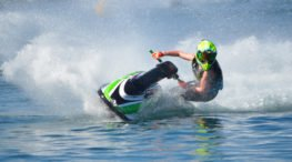 person operating a jet ski on the water