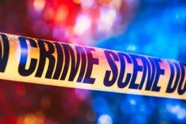 image of crime scene tape in front of crime scene