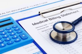 medical bills and records with calculator