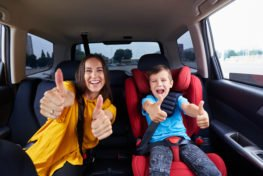 children buckled into car seat correctly