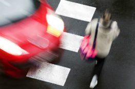 pedestrian getting struck by car in an accident at crosswalk