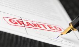 pen signing a grant