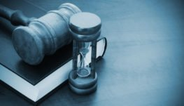a gavel and hour glass
