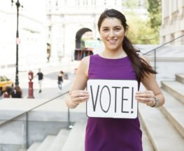 young female with vote sign