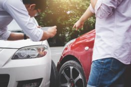 Two Drivers Man Arguing After A Car Traffic Accident Collision