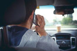 man making a phone call while driving