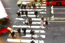 pedestrians walking through a crosswalk