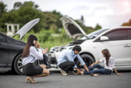 person using phone to call about car accident