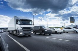 Semi trucks and cars traveling on San Antonio highway
