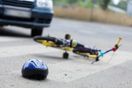 bicycle and helmet on the road after accident