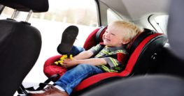 a child on a carseat