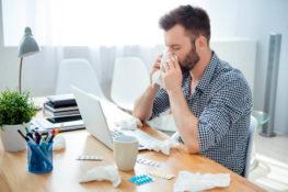 man in an office with coronavirus