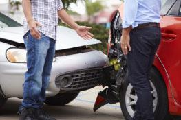 Men negotiating after car accident