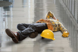 construction worker injured after slipping and falling