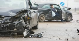 two broken black cars after accident