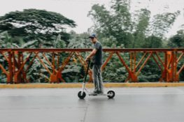 man riding e-scooter in San Antonio