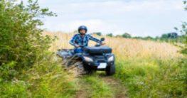 man riding an ATV