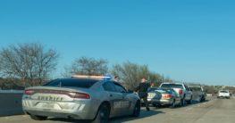 Police car beside car accident scene