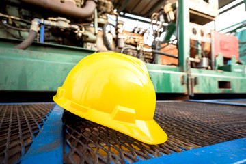 yellow hard hat on an oil field site